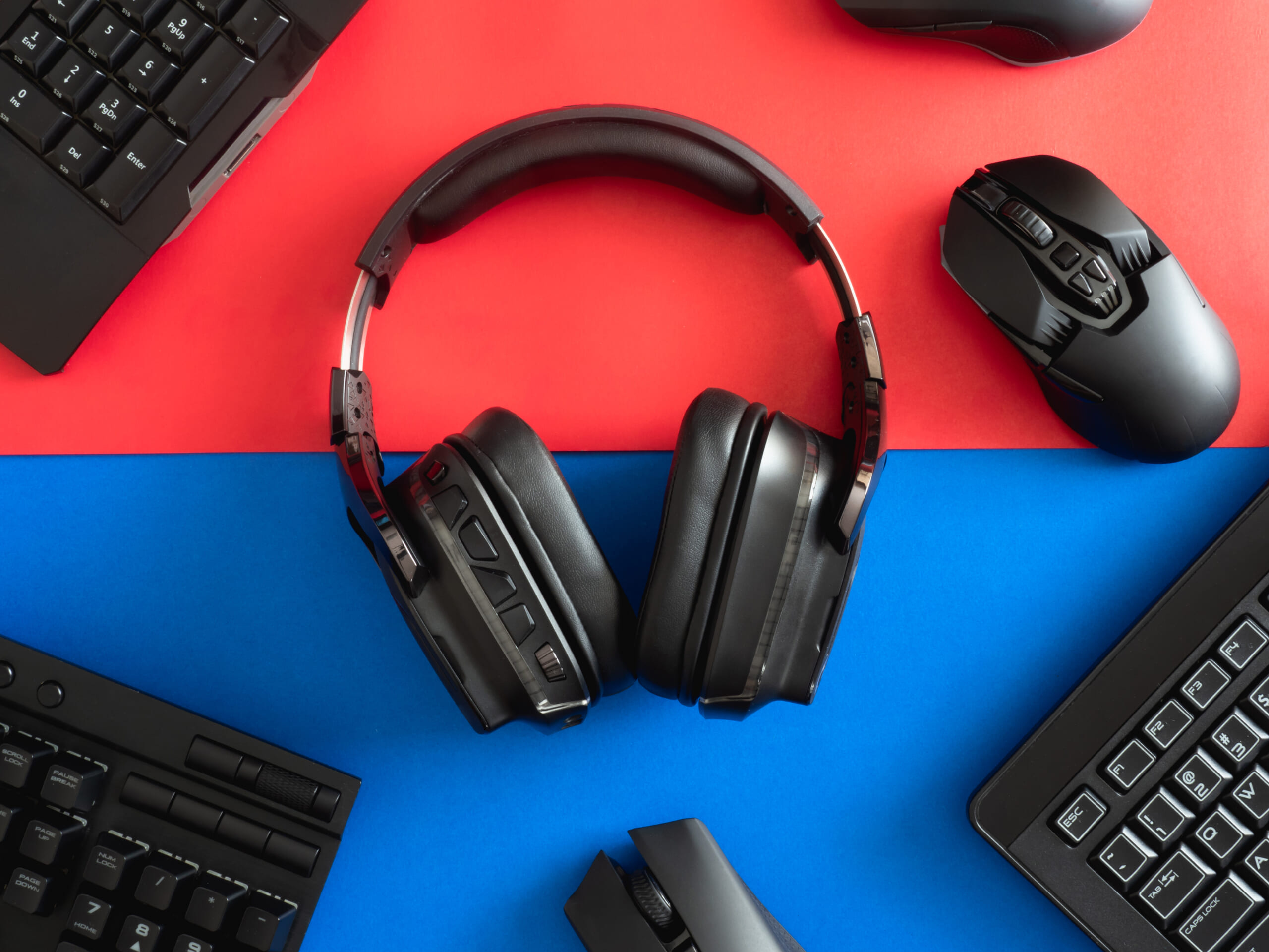 Top-view-a-gaming-gear-mouse-keyboard-headphone-and-mouse-pad-on-table-background.jpg